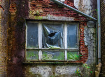 Window under plastic film in the brick wall, lost place Royalty Free Stock Images