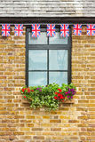Window with Union Jack bunting above. It Royalty Free Stock Image