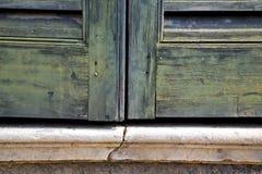 Window  varese palaces i      wood venetian blind concrete  bric Royalty Free Stock Images