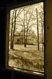 Window view across the yard (sepia) Royalty Free Stock Photography