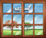 A window with a view of the airplane outside Royalty Free Stock Photography