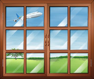 A window with a view of the airplane in the sky Royalty Free Stock Photos