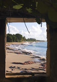 Window view of beach. And ocean from an old beach hut in Fredriksted, St. Croix, U.S. Virgin Islands Royalty Free Stock Images