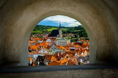 A Window View of the Church of St. Vitus and Roofs in Cesky Krumlov stock images