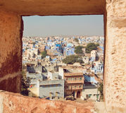 Window view with colorful concrete constructions of city in India Stock Images