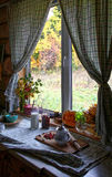 Window view with curtains. Wooden house window view with curtains Royalty Free Stock Photo