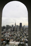 Window view of downtown San Francisco. A view of Financial District buildings in San Francisco through the Coit Tower Royalty Free Stock Images