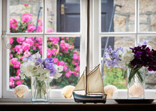 Window view with flowers and sea shells Stock Image