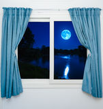 Window view of the full moon Stock Photography