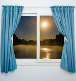 Window view of the full moon Royalty Free Stock Image
