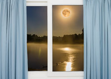 Window view of the full moon Royalty Free Stock Images