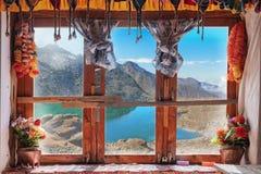Window view with Gokyo lake royalty free stock image