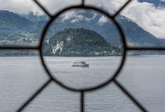 Window View of Lake Como and Boat Stock Images