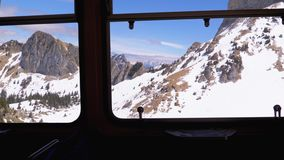 Window view of a moving mountain train on the snowy Switzerland Alps. Montreux City. Window view of a moving mountain train on the snowy Switzerland Alps. The stock video footage