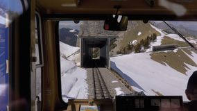 Window view of a moving mountain train on the Snowy Switzerland Alps. Montreux City. Window view of a moving mountain train on the Snowy Switzerland Alps. The stock video