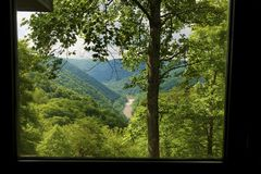 Window view of New River Gorge in West Virginia. A view seen from a window of New River, a national river, and the gorge of the same name stock images