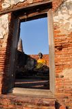 The window view of Old Statue buddha at Ayutthaya Royalty Free Stock Photography