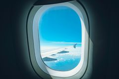 Window View From Passenger Seat On Commercial Airplane. wing of the aircraft can be seen in the window royalty free stock photo