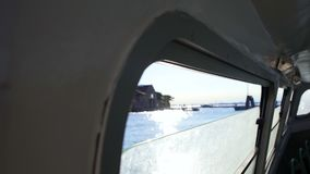 Window view of river and buildings from vaporetto cabin, Venice water tour. Stock footage stock video footage