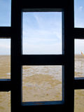 Window with view of the sea Stock Photos