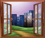 A window with a view of the tall buildings Stock Photo