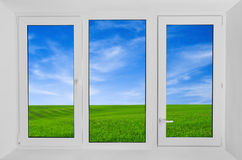 Window  with view to green field Stock Photography