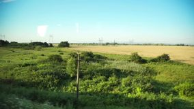 Window view from a train. Window view on the fields from a train stock video