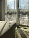 Window view. Watching winter scenery on a sunny day from living Royalty Free Stock Photo