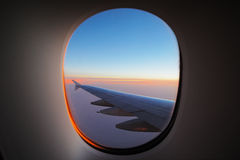 A window view of the wing at dawn Stock Image