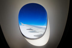 A window view of the wing at dawn Royalty Free Stock Image