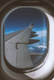 Window view of wing of an jet airplane Royalty Free Stock Images
