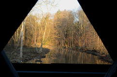 Window view from wooden covered bridge on rural road Stock Photos