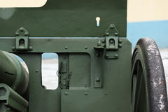 Window for viewing in a protective shield on Russia's historical military green gun.  stock image