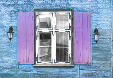 Window vintage with lanterns wooden house. Blue Stock Photo