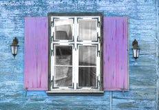 Window vintage with lanterns wooden house Stock Photo