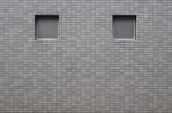 Window void on grey color tile wall. In Japan Royalty Free Stock Photos