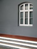Window in the wall. Portrait photo of a colonial window in a gray wall stock photography