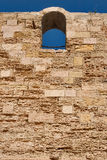 Window in a wall. If castle wall, lit by sun Royalty Free Stock Image