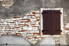 Window and wall. Old  closed window on some stone and bricks wall Stock Image