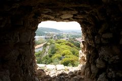 Window in a wall of the ancient fortress of Obidos. Portugal Stock Photos