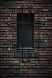 Window in a wall of bricks Stock Photo
