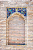 Window in the wall, Bukhara. Window with tiles ornaments in the wall, Bukhara, Uzbekistan Stock Photo