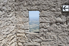 Window in the wall of the castle Stock Photos