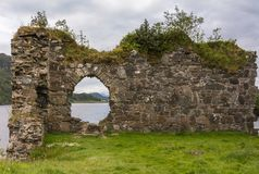 Window in wall of Castle Strome with Loch Carron, Scotland. Royalty Free Stock Photo