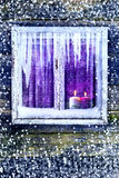 Window wall Christmas lighted candles. Lit candles in the window. Time Christmas and New Year Royalty Free Stock Image