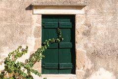 Window in the wall, crete, Greece stock photography