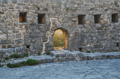 The window in the wall of the fortress. Montenegro ruins of a medieval town Old Bar royalty free stock images