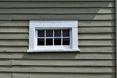 Window in wall of log cabin Stock Photos