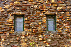 Window on wall made from rocks Royalty Free Stock Photo