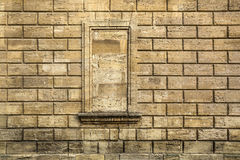 Window and wall of naturral stone as background. Royalty Free Stock Photo
